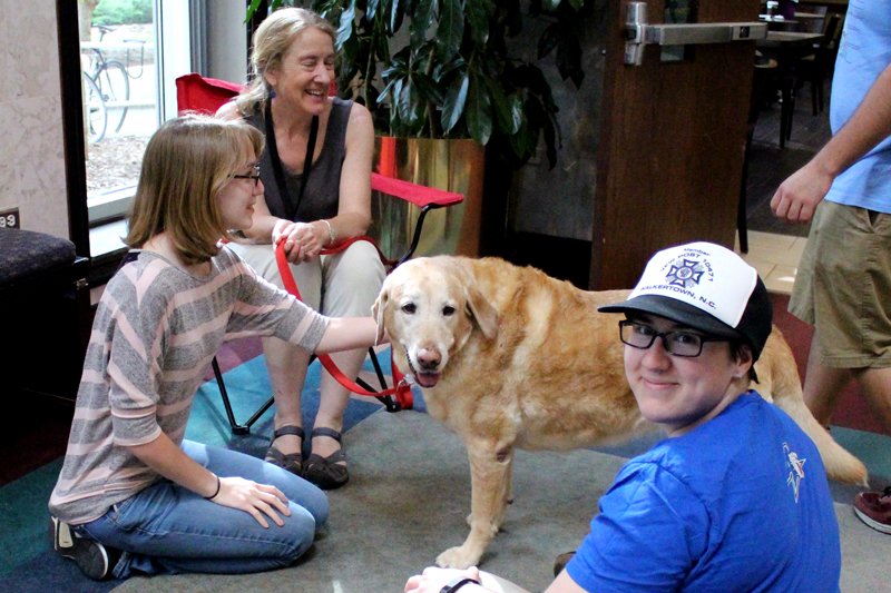Yellow Labrador Retriever Therapy Dog and Students